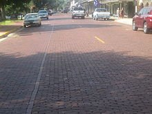 220px-Historic_brick_street_in_Natchitoc