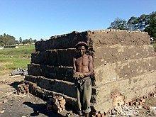 220px-Xhosa_brickmaker_at_kiln_near_Ngco